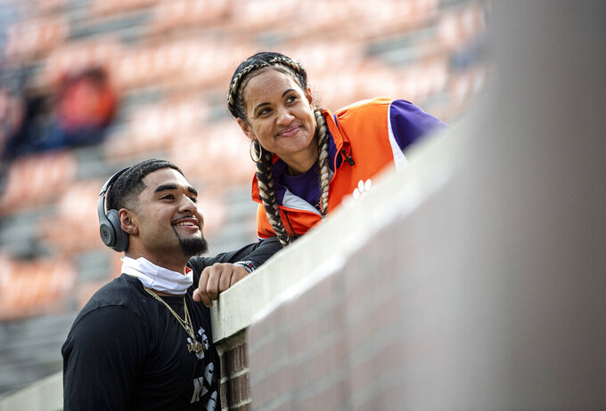 Clemson quarterback D.J. Uiagalelei (5) smiles with his mother Tausha Uiagalelei before an NCAA college football game against Boston College on Saturday, Oct. 31, 2020 in Clemson, S.C.  ( Josh Morgan/Pool Photo via AP)