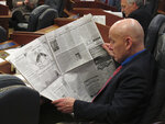 Alaska state Rep. Dan Ortiz of Ketchikan reads his hometown newspaper before the start of the House floor session on Wednesday, May 15, 2019, Juneau, Alaska. Wednesday marked a constitutional deadline for the end of the regular session. (AP Photo/Becky Bohrer)