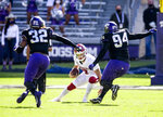 Oklahoma Sooners quarterback Spencer Rattler (7) looks for room against TCU defensive end Ochaun Mathis (32) and defensive tackle Corey Bethley (94) during the first half of an NCAA College football game, Saturday, Oct. 24, 2020, in Fort Worth, Texas. (AP Photo/Brandon Wade)
