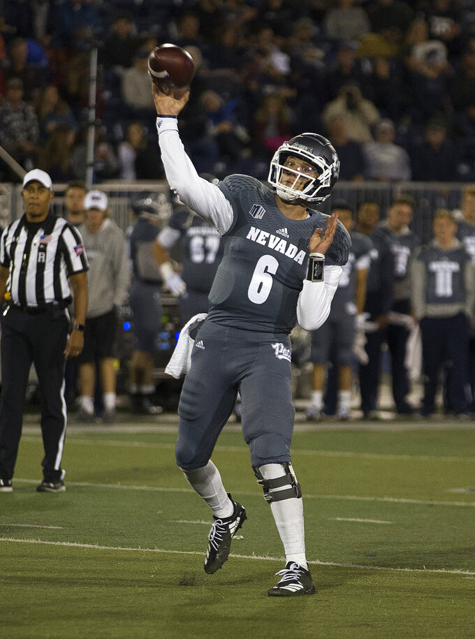 Nevada quarterback Ty Gangi (6) throws against San Diego State in the first half of an NCAA college football game in Reno, Nev., Saturday, Oct. 27, 2018. (AP Photo/Tom R. Smedes)