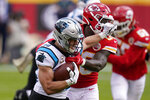 Carolina Panthers running back Christian McCaffrey, left, runs against Kansas City Chiefs linebacker Willie Gay Jr. during the first half of an NFL football game in Kansas City, Mo., Sunday, Nov. 8, 2020. (AP Photo/Orlin Wagner)