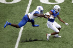 Kansas wide receiver Andrew Parchment (4) is tackled by Indiana State linebacker Jonas Griffith during the second half of an NCAA college football game Saturday, Aug. 31, 2019, in Lawrence, Kan. Kansas won 24-17. AP Photo/Charlie Riedel)
