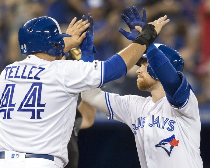 Toronto Blue Jays' Brandon Drury, right, celebrates his two-run home run against the Boston Red Sox with teammate Rowdy Tellez in the sixth inning of a baseball game in Toronto, Wednesday, July 3, 2019. (Fred Thornhill/The Canadian Press via AP)
