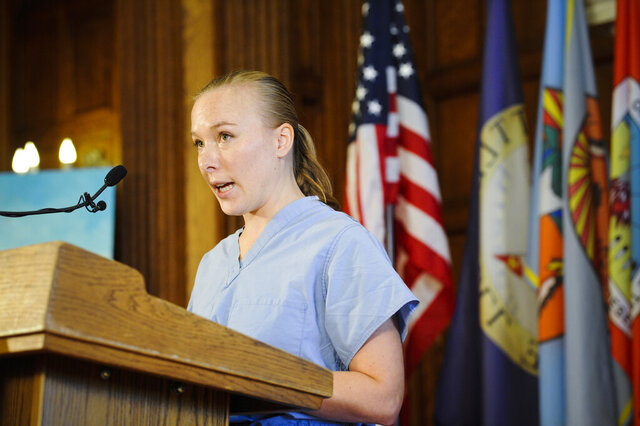 Charlotte Skinner, an Emergency Room nurse at St. Peter's Health, speaks at a Covid-19 press call hosted by Gov. Steve Bullock at the State Capitol, Tuesday, Oct. 20, 2020, in Helena, Mont. Registered nurse Skinner of Helena says healthcare workers come from a variety of political, socioeconomic and religious backgrounds, but they reach common ground on science. (Thom Bridge/Independent Record via AP)