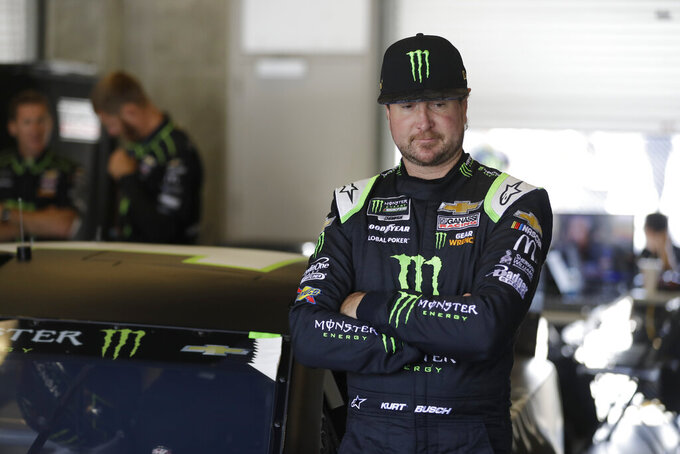 Monster Energy NASCAR Cup Series driver Kurt Busch waits in his garage before practice for the NASCAR Brickyard 400 auto race at the Indianapolis Motor Speedway, Saturday, Sept. 7, 2019 in Indianapolis. (AP Photo/Darron Cummings)
