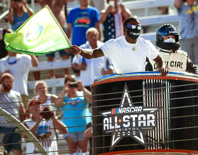 FILE - In this Wednesday night, July 15, 2020, file photo, former University of Tennessee and current New Orleans Saints football player Alvin Kamara waves the green flag to start the NASCAR All-Star auto race at Bristol Motor Speedway in Bristol, Tenn. NASCAR is ready to embrace all genders, ethnicities and backgrounds as moves ahead in its push for racial diversity.  (David Crigger/Bristol Herald Courier via AP, File)