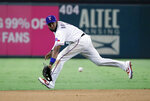 Texas Rangers shortstop Elvis Andrus (1) fields a ground out by Boston Red Sox's J.D. Martinez in the fifth inning of a baseball game in Arlington, Texas, Wednesday, Sept. 25, 2019. (AP Photo/Tony Gutierrez)