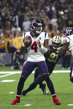 Houston Texans quarterback Deshaun Watson (4) looks downfield for a receiver in an NFL game against the New Orleans Saints, Monday, Sept. 9, 2019, in New Orleans. The Saints defeated the Texans 30-28. (Margaret Bowles via AP)