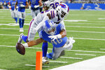 Detroit Lions running back Craig Reynolds (46), defended by Buffalo Bills cornerback Rachad Wildgoose (32) scores on a 24-yard rushing touchdown during the second half of a preseason NFL football game, Friday, Aug. 13, 2021, in Detroit. (AP Photo/Duane Burleson)