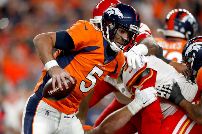 Denver Broncos quarterback Joe Flacco (5) scrambles against the Kansas City Chiefs during the first half of an NFL football game, Thursday, Oct. 17, 2019, in Denver. (AP Photo/David Zalubowski)