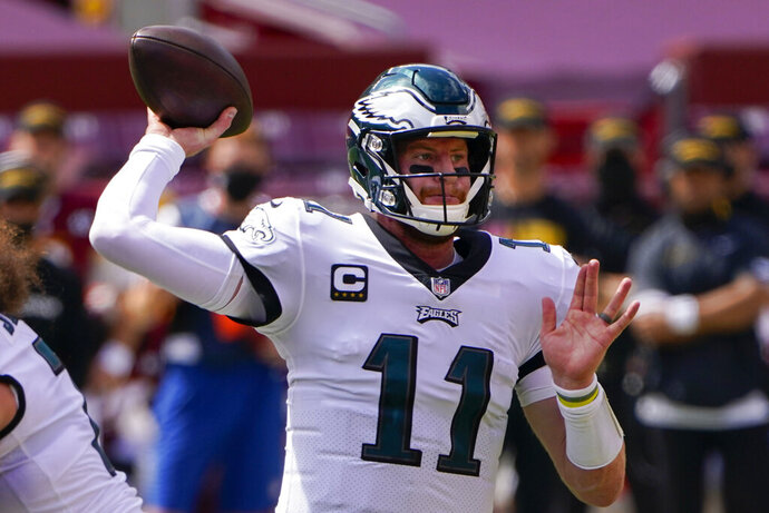 Philadelphia Eagles quarterback Carson Wentz passes the ball against the Washington Football Team during the first half of an NFL football game, Sunday, Sept. 13, 2020, in Landover, Md. (AP Photo/Susan Walsh)