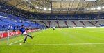 FILE - In this May 24, 2020, file photo, Schalke's Daniel Caligiuri kicks the ball in front of empty seats during the German Bundesliga soccer match between FC Schalke 04 and FC Augsburg at the Veltins-Arena in Gelsenkirchen, Germany. (AP Photo/Martin Meissner, Pool, File)