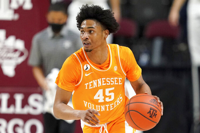 FILE - In this Jan. 9, 2021, file photo, Tennessee guard Keon Johnson brings the ball up against Texas A&M during an NCAA college basketball game in College Station, Texas. Johnson was chosen in the first round of the NBA draft Thursday, July 29, 2021. (AP Photo/Sam Craft, File)