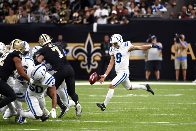 Indianapolis Colts punter Rigoberto Sanchez (8) kicks a punt that was blocked in the first half of an NFL football game against the New Orleans Saints in New Orleans, Monday, Dec. 16, 2019. (AP Photo/Bill Feig)