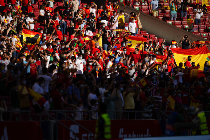 Soccer fans who have been allowed into the ground watch the international friendly soccer match between Spain and Portugal at the Wanda Metropolitano stadium in Madrid, Spain on Friday June 4, 2021. (AP Photo/Manu Fernandez)