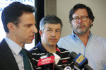 Ian Hockley, center, father of Sandy Hook Elementary School student Dylan Hockley, and Bill Sherlach, right, husband of Sandy Hook Elementary School psychologist Mary Sherlach, look on as attorney Josh Koskoff speaks a news conference in Bridgeport, Conn. Thursday, March 14, 2019. Gun-maker Remington can be sued over how it marketed the rifle used to kill 20 children and six educators at Sandy Hook Elementary School in 2012, a divided Connecticut Supreme Court ruled Thursday. (Ned Gerard/Hearst Connecticut Media via AP)