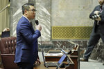 Washington Sen. Joe Nguyen, D-White Center, speaks on the Senate floor on a bill he sponsored that adopts California's emission rules for vehicles in Washington state, Wednesday, Jan. 15, 2020, at the Capitol in Olympia, Wash. The measure passed and will now go to the state House. (AP Photo/Ted S. Warren)