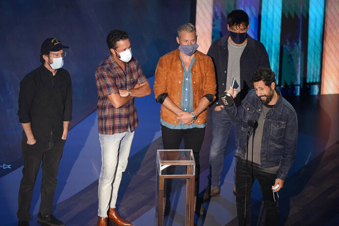Old Dominion accepts the group of the year award during the 55th annual Academy of Country Music Awards at the Grand Ole Opry House on Wednesday, Sept. 16, 2020, in Nashville, Tenn. (AP Photo/Mark Humphrey)
