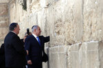 Israeli Prime Minister Benjamin Netanyahu accompanied by U.S. Secretary of State Mike Pompeo touches the stones of the Western Wall during his visit to the site in Jerusalem's Old City, Thursday, March 21, 2019. (Jim Young/Pool Image via AP)
