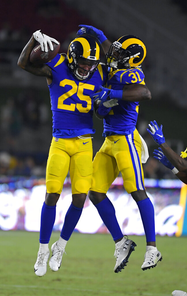 Los Angeles Rams cornerback Kevin Peterson, left, celebrates his interception with Darious Williams (31) during the second half of an NFL preseason football game against the Denver Broncos Saturday, Aug. 24, 2019, in Los Angeles. (AP Photo/Mark J. Terrill)