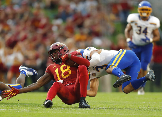 Iowa State wide receiver Hakeem Butler, left, is wrapped up by South Dakota State safety Joshua Manchigiah during the first half of an NCAA college football game, Saturday, Sept. 1, 2018, in Ames, Iowa. (AP Photo/Matthew Putney)