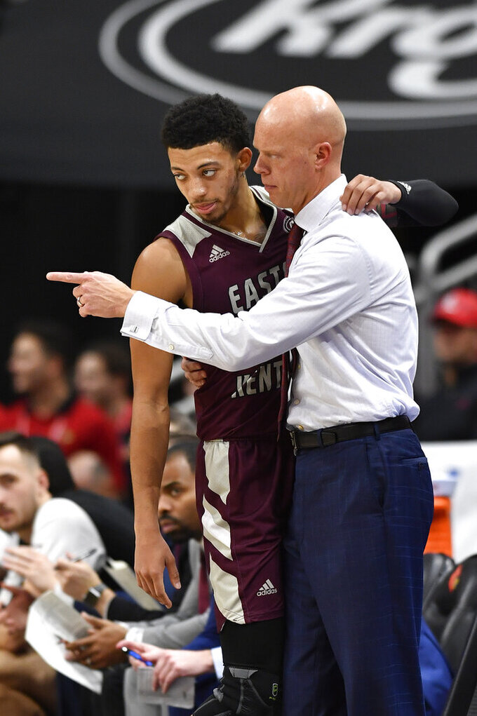 Eastern Kentucky head coach A.W. Hamilton gives instruction to guard Houston King (14) during the second half of an NCAA college basketball game in Louisville, Ky., Saturday, Dec. 14, 2019. Louisville won 99-67. (AP Photo/Timothy D. Easley)