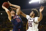 Arizona forward Stone Gettings (13) shoots over Arizona State forward Taeshon Cherry (35) during the first half of an NCAA college basketball game Saturday, Jan. 25, 2020, in Tempe, Ariz. (AP Photo/Ross D. Franklin)
