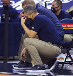 Virginia coach Tony Bennett reacts to a play during the team's NCAA college basketball game against North Carolina State on Wednesday, Feb. 24, 2021, in Charlottesville, Va. (Andrew Shurtleff/The Daily Progress via AP, Pool)