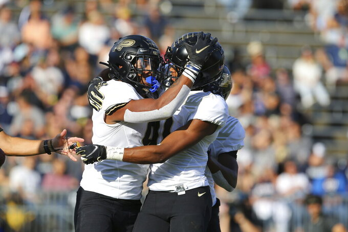 Purdue wide receiver Mershawn Rice, left, celebrates a touchdown with wide receiver Milton Wright, right, during the second half of an NCAA football game against Connecticut on Saturday, Sept. 11, 2021, in East Hartford, Conn. (AP Photo/Stew Milne)