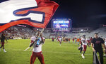 Jacksonville State wide receiver Michael Pettway (2) waves a flag on the field after the team's 20-17 win over Florida State in an NCAA college football game Saturday, Sept. 11, 2021, in Tallahassee, Fla. (AP Photo/Phil Sears)