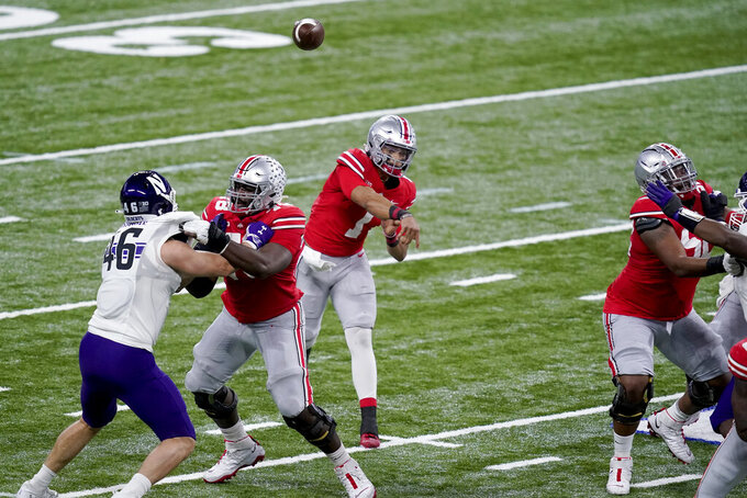 Ohio State quarterback Justin Fields (1) throws during the first half of the Big Ten championship NCAA college football game against Northwestern, Saturday, Dec. 19, 2020, in Indianapolis. (AP Photo/Darron Cummings)