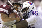 Mississippi State running back Kylin Hill (8) is tackled by Louisiana Tech defensive end Jaylon Ferguson (45) during the first half of an NCAA college football game on Saturday, Nov. 3, 2018, in Starkville, Miss. (AP Photo/Jim Lytle)