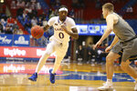 Kansas guard Marcus Garrett drive the lane during the second half of the team's NCAA college basketball game against West Virginia on Tuesday, Dec. 22, 2020, in Lawrence, Kan. (Evert Nelson/The Topeka Capital-Journal via AP)