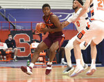 Virginia Tech guard Nahiem Alleyne (4) works the ball against Syracuse during an NCAA college basketball game at the Carrier Dome, Syracuse, N.Y., Saturday Jan. 23, 2021. (Scott Schild/The Post-Standard via AP)