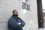 """James Rudd is seen outside of his workplace at the AT&T building in downtown Milwaukee, where he works as a janitor, on July 13, 2021. Rudd is fighting to double the minimum wage in Wisconsin from $7.25 per hour to $15 per hour. Rudd says he now makes more than $15 an hour — and thinks everyone should make at least that. """"Fifteen dollars is just a start. We want to take vacations. We want to be able to live the American dream,"""" he says. (Isaac Wasserman/Wisconsin Watch via AP)"""