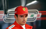 Ferrari driver Charles Leclerc of Monaco looks on in the pit lane after the first free practice at the 'Sochi Autodrom' Formula One circuit, in Sochi, Russia, Friday, Sept. 27, 2019. The Formula one race will be held on Sunday. (AP Photo/Luca Bruno)
