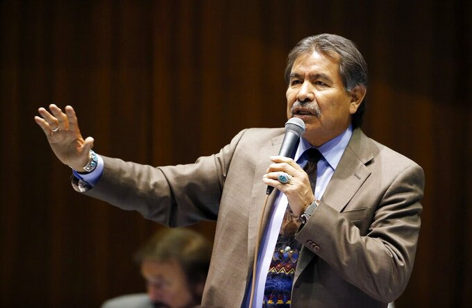 FILE - In this March 4, 2015, file photo, then-Rep. Albert Hale, D-St. Michaels, talks at the Arizona Capitol in Phoenix. Hale, who served as the second president of the Navajo Nation in the 1990s, died Tuesday, Feb. 2, 2021. A cause of death and an exact age for Hale was not immediately available. But tribal officials said Hale was in his early 70s and was battling COVID-19 when the Navajo Nation Council heard of his condition last Friday. (AP Photo/Ross D. Franklin, File)