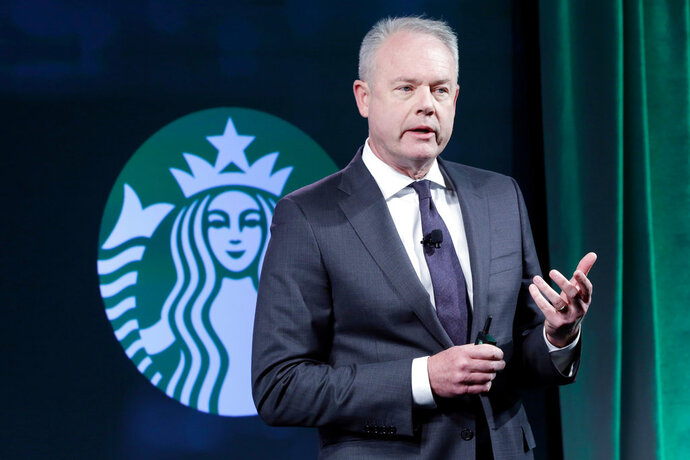 "FILE- In this Dec. 7, 2016, file photo, Starbucks President and COO Kevin Johnson presents during the Starbucks 2016 Investor Day meeting, in New York. After two black men were arrested at a Philadelphia Starbucks store last week, CEO Kevin Johnson said the company will review what happened and train workers on ""unconscious bias."" Johnson, in an interview with The Associated Press, Monday, April 16, 2018, said the arrests were ""reprehensible"" and that it should not have happened. (AP Photo/Richard Drew, File)"