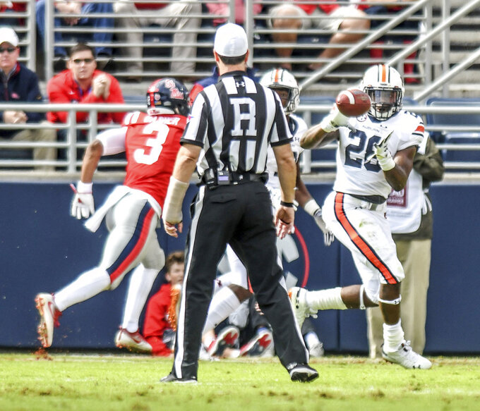 Auburn running back JaTarvious Whitlow (28) catches a pass and runs into the end zone for a touchdown against Mississippi during an NCAA college football game at Vaught-Hemingway Stadium in Oxford, Miss., Saturday, Oct. 20, 2018. (Bruce Newman/The Oxford Eagle via AP)