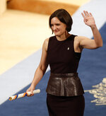 FILE - In this Friday Oct. 23, 2015 file photo, Esther Duflo of France waves after receiving the Princess of Asturias award for Social Sciences from Spain's King Felipe VI at a ceremony in Oviedo, northern Spain. The 2019 Nobel prize in economics has been awarded to Abhijit Banerjee, Esther Duflo and Michael Kremer