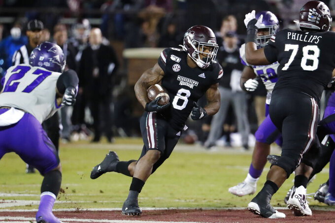 Mississippi State running back Kylin Hill (8) runs for a first down against Abilene Christian during the first half of an NCAA college football game, Saturday, Nov. 23, 2019, in Starkville, Miss. (AP Photo/Rogelio V. Solis)