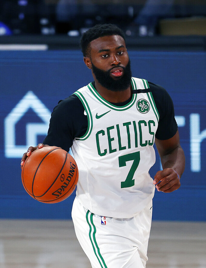 Boston Celtics' Jaylen Brown handles the ball during the second half of an NBA basketball game against the Memphis Grizzlies  Tuesday, Aug. 11, 2020, in Lake Buena Vista, Fla. (AP Photo/Mike Ehrmann, Pool)