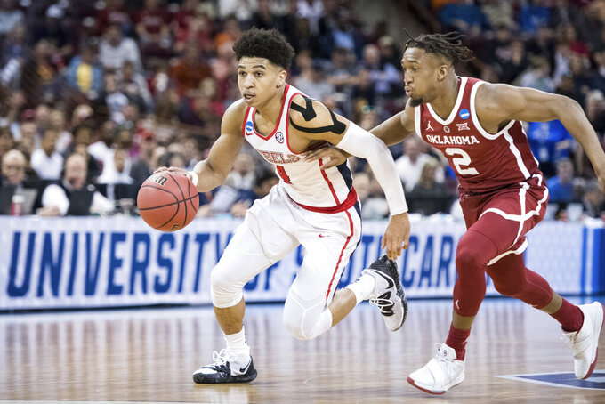 Mississippi guard Breein Tyree (4) dribbles the ball against Oklahoma guard Aaron Calixte (2) during a first-round game in the NCAA men's college basketball tournament Friday, March 22, 2019, in Columbia, S.C. Oklahoma defeated Mississippi 95-72. (AP Photo/Sean Rayford)