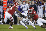 Oklahoma defensive lineman LaRon Stokes (96) and Kenneth Murray (9) sack TCU quarterback Max Duggan (15) in the first half of an NCAA college football game in Norman, Okla., Saturday, Nov. 23, 2019. (AP Photo/Sue Ogrocki)