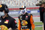 Driver Martin Truex Jr. walks to his car prior to qualifying for the NASCAR Cup Series auto race at Charlotte Motor Speedway Sunday, May 24, 2020, in Concord, N.C. (AP Photo/Gerry Broome)
