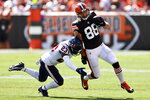 Cleveland Browns tight end Harrison Bryant (88) is tackled by Houston Texans strong safety Eric Murray (23) during the first half of an NFL football game, Sunday, Sept. 19, 2021, in Cleveland. (AP Photo/Ron Schwane)
