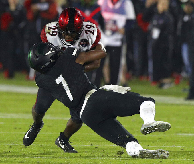 San Diego State running back Juwan Washington (29) gets tackled by Ohio safety Javon Hagan (7) in the second half of the Frisco Bowl NCAA college football game, Wednesday, Dec. 19, 2018, in Frisco, Texas. (AP Photo/Richard W. Rodriguez)