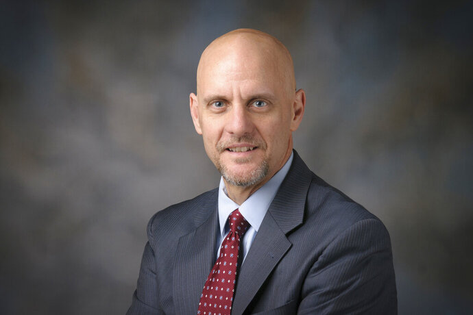"""This 2014 photo provided by The University of Texas MD Anderson Cancer Center shows Stephen Hahn. President Donald Trump's nominee to lead the Food and Drug Administration sidestepped questions on the future of a 2-month-old plan to ban most flavored e-cigarettes. Hahn told Senate lawmakers on Wednesday, Nov. 20, 2019, that a recent wave of underage vaping is an """"urgent, important crisis"""" and demands """"aggressive action."""" But he said he wants to review more data before deciding on an approach.  (The University of Texas MD Anderson Cancer Center via AP)"""