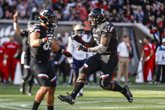 Cincinnati running back Michael Warren II (3) celebrates after scoring a touchdown in the first half of an NCAA college football game against Navy, Saturday, Nov. 3, 2018, in Cincinnati. (AP Photo/John Minchillo)