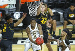 Wichita State's Trey Wade makes a reverse layup against Missouri's Parker Braun (42) and Drew Buggs (2) during the first half of a college basketball game on Sunday, Dec. 6, 2020, in Wichita, Kan. (Travis Heying/The Wichita Eagle via AP)